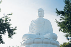 White Buddha Statue at Long Son Pagoda. Big Buddha Statue in Nha Trang, Vietnam. Sunny day, blue sky stock photos