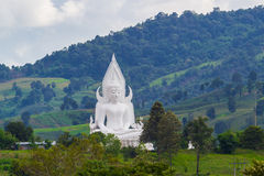 White buddha statue in the mountain Royalty Free Stock Photo