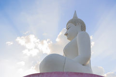 White Buddha statue and ray. Stock Photos