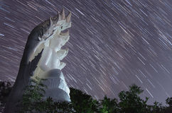 White Buddha statue with startrails Royalty Free Stock Image