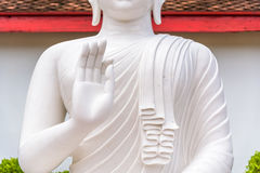 White buddha statue. The White buddha statue in Thai temple Royalty Free Stock Image