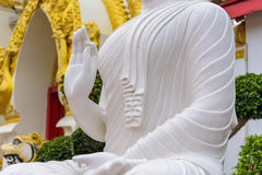 White buddha statue. The White buddha statue in Thai temple Stock Photo