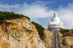 White Buddha Statue Vietnam Steps Cliffs Sunny Asia Religious Mo stock image