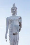 White buddha statue walking Stock Photos