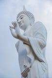 White buddha statue walking Royalty Free Stock Photo