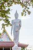 White buddha statue walking Stock Photo