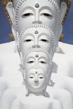 White buddha statue well alignment in front of blue sky and mountain. In thailand royalty free stock photo