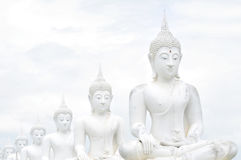 White Buddha statues. Pattern of white Buddha statues in Thailand Royalty Free Stock Images
