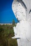 White buddha status on blue sky background Royalty Free Stock Images