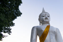 The White buddha status on blue sky background in Thailand. Stock Photos
