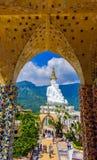 White buddha in Wat Phra That Pha Son Kaew temple at Phetchabun stock photos
