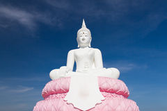 White Buddhaand sky blue Royalty Free Stock Photography