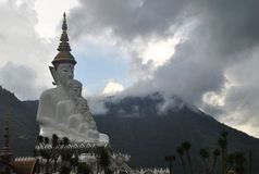 White buddhism Sit and Meditation architecture with Background mountain and cloud wild view thailand. White buddhism Sit and Meditation architecture with Cloud stock photography