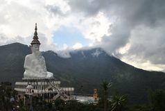 White buddhism Sit and Meditation architecture with Background mountain and cloud wild view. White buddhism Sit and Meditation architecture with Cloud and stock photography
