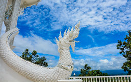 White buddhist dragon. White buddist dragon and blue sky Stock Photo