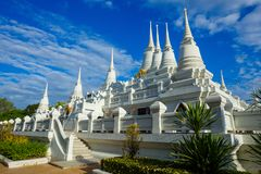 White Buddhist Pagoda with multiple spires at Wat Asokara Temple in Thailand Stock Photo