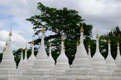 White buddhist pagodas with trees background, Myanmar Stock Photo