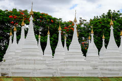 White buddhist pagodas with trees background, Myanmar Stock Photography
