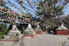 White Buddhist stupas under lots of Buddhist. Stock Photography