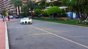 White Bugatti Veyron. Monte-Carlo, Monaco - May 17, 2016: White Supercar Bugatti Veyron 16.4 Grand Sport Parked in Front of the Grimaldi Forum in Monaco stock video