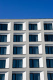 White building against a blue sky Royalty Free Stock Photo