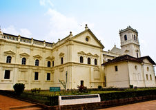 White building-a Church. This white building is in fact a 17th century church called Se Cathedralwhich is now jointly maintained by Archaeological Survey of Royalty Free Stock Images