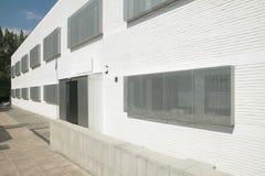 White building facade with metallic windows Stock Photo