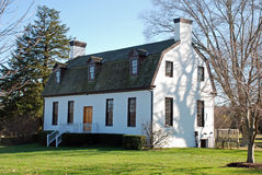 White Building Gambrel Roof. A building built in the early 1800s, renovated around 1930 Stock Photography