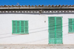 White building with green shutters in El Terreno Stock Image