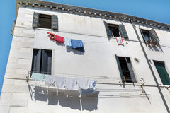 White  building with hanging laundry in Venice ,Italy Royalty Free Stock Photo