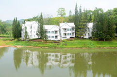 White building. Near lake after raining at brookside valley, Rayong, Thailand Stock Photo