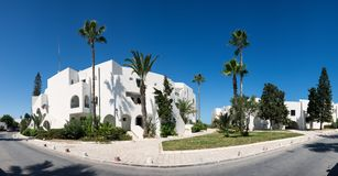 White building, palm trees. Tunisia, travel. Panorama. White building palm trees, Tunisia, travel Stock Photography