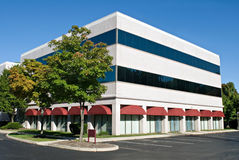 White Building and Red Awnings royalty free stock image