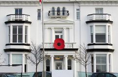 White building with red poppy flower. Symbol at the balcony in southport liverpool, england, united kingdom Royalty Free Stock Photos