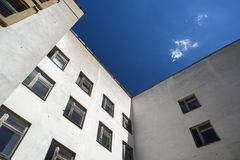 White building with square windows against blue sky Royalty Free Stock Photos