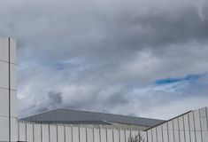 Cloudy sky on stormy day roof royalty free stock photos