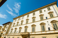 White building under a blue sky in Florence. Italy Royalty Free Stock Photo