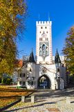 Bavarian gate and trees in autumn colors, Landsberg am Lech, Germany stock images