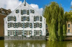 A white building by the river Nete in Lier, Belgium. A white building and Willow tree by the river Nete in Lier, Belgium Royalty Free Stock Images