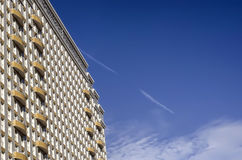 The white building with yellow balconies, side view. Royalty Free Stock Images