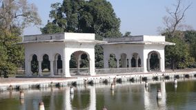 White buildings. The Shalimar Gardens (Urdu: شالیمار باغ), sometimes written Shalamar Gardens, were built by the Mughal emperor Shah Jahan in Lahore Royalty Free Stock Photography