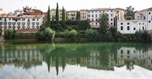 Colorful houses reflected in river Brenta in Bassano del Grappa, Italy royalty free stock photography