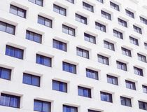 White Buildings With Blue Glass Windows Stock Images
