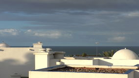 White buildings in the morning sunshine. Abstract peaceful tropical resort in the morning sunlight, Morocco.White walls, domed and flat roofs stock footage