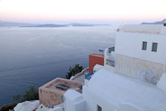 White buildings of Oia village and Aegean sea at sunset, Santori Stock Photos