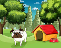 A white bulldog with a dog food outside his dog house Royalty Free Stock Photo