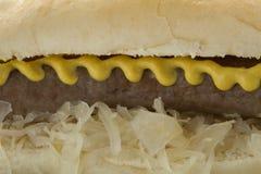 White bun with sauerkraut, sausage and mustard Stock Images