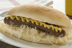 White bun with sauerkraut, sausage and mustard Royalty Free Stock Image