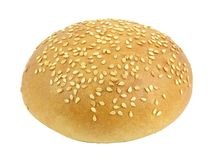 White bun with sesame seeds round whole for a Burger isolated on white background with clipping path. Full depth of field