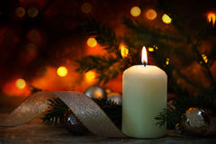 White burning candle with christmas decoration, spruce twigs, ba Royalty Free Stock Images